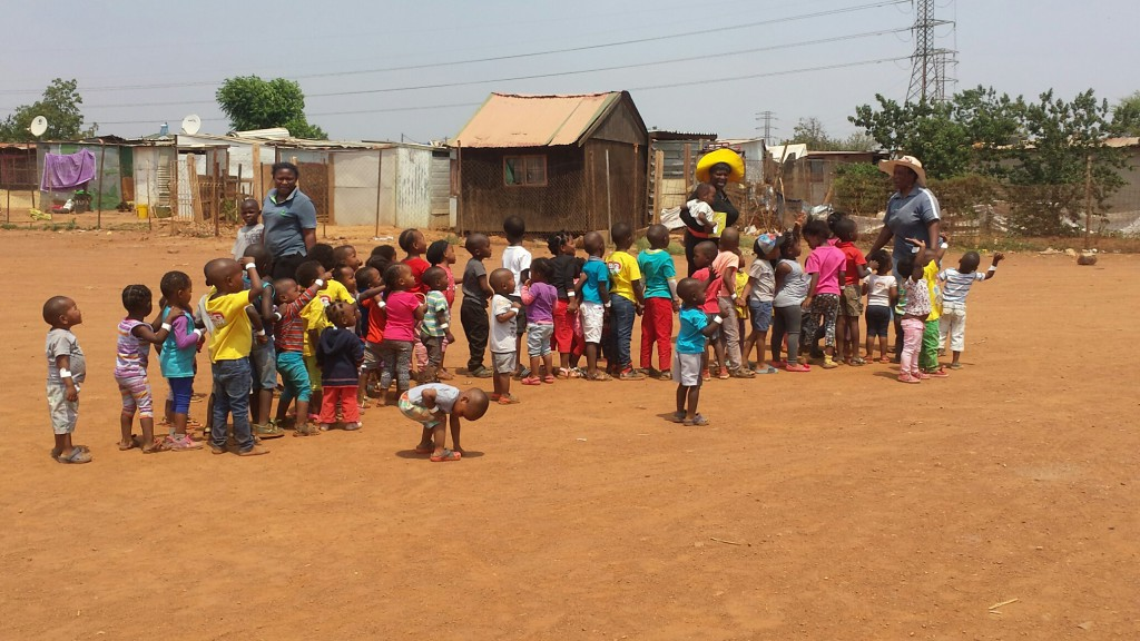 The creche kids lined up to leave and amazed at a police helicopter that kept circling overhead!